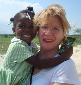 Sobus enjoys a visit with Metinise, a Haitian girl she sponsors through a local charity.